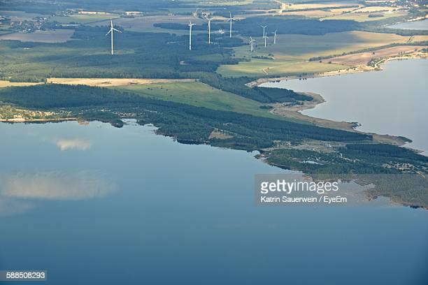 Aerial View Of Wind Turbines Green Landscape By Lake