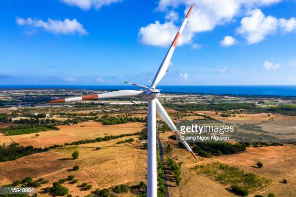 aerial view of wind turbines on a sunny day - generator stock pictures, royalty-free photos & images