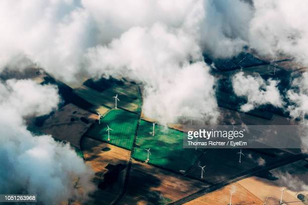 aerial view of wind turbines on agricultural field - mill stock pictures, royalty-free photos & images