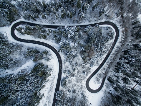 Aerial View Of Winding Road In Forest During Winter - gettyimageskorea