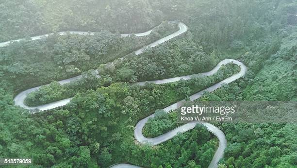 aerial view of winding road in forest - tianmen stock pictures, royalty-free photos & images