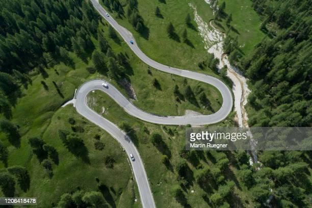 aerial view of winding road with hairpin, falzarego pass. - bergpass stockfoto's en -beelden