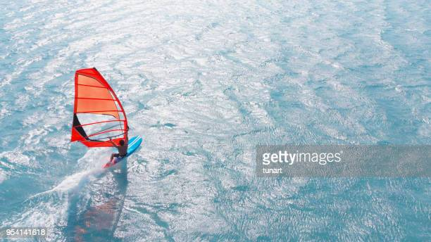 aerial view of windsurfing - windsurfing stock pictures, royalty-free photos & images