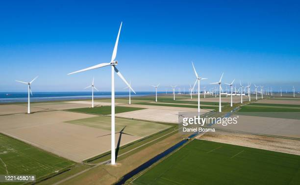 aerial view of windturbines in a coastal polder in the netherlands - 干拓地 ストックフォトと画像