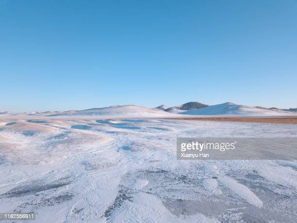aerial view of winter snow scene - extreme terrain stock pictures, royalty-free photos & images