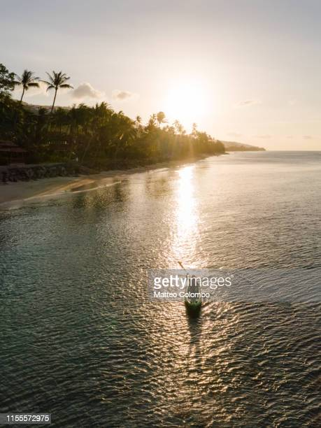 aerial view of woman kayaking at sunset, ko samui island, thailand - kayak stock pictures, royalty-free photos & images