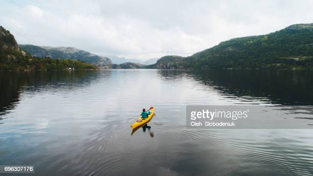 aerial view of woman kayaking on the lake in mountains - kayak stock pictures, royalty-free photos & images