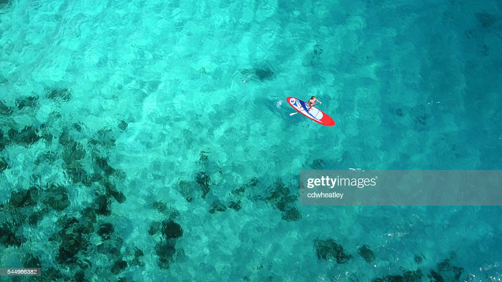 Aerial view of woman on paddleboard : Stock Photo