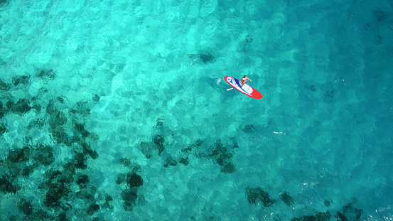 Aerial view of woman on paddleboard 544966382