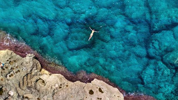 Aerial View Of Woman Swimming On Sea