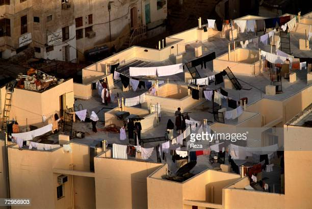Aerial view of women and strings of drying laundry on rooftops of residental homes February 2003 in Mecca Saudi Arabia