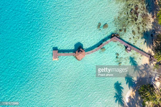 aerial view of wooden bar in sea and hut with nice blue sky in koh kood at trat, thailand. asia summer, travel, vacation and holiday concept. - thailand stock pictures, royalty-free photos & images