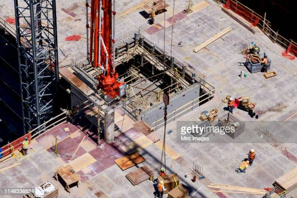 aerial view of workers at construction site - construction material stock pictures, royalty-free photos & images