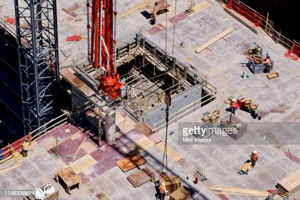 aerial view of workers at construction site - tour structure bâtie photos et images de collection