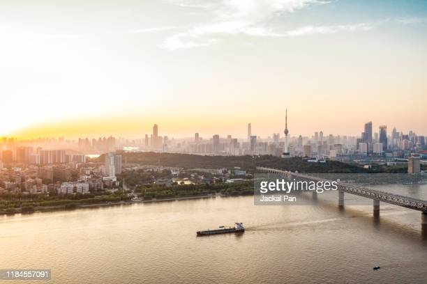 aerial view of wuhan skyline - wuhan stock photos and pictures