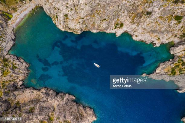 aerial view of yacht near the rocky coast in turkey. aegean sea - rocky coastline stock pictures, royalty-free photos & images