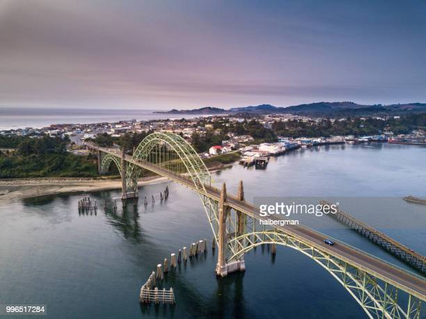 aerial view of yaquina bay bridge and newport, oregon - newport beach stock pictures, royalty-free photos & images