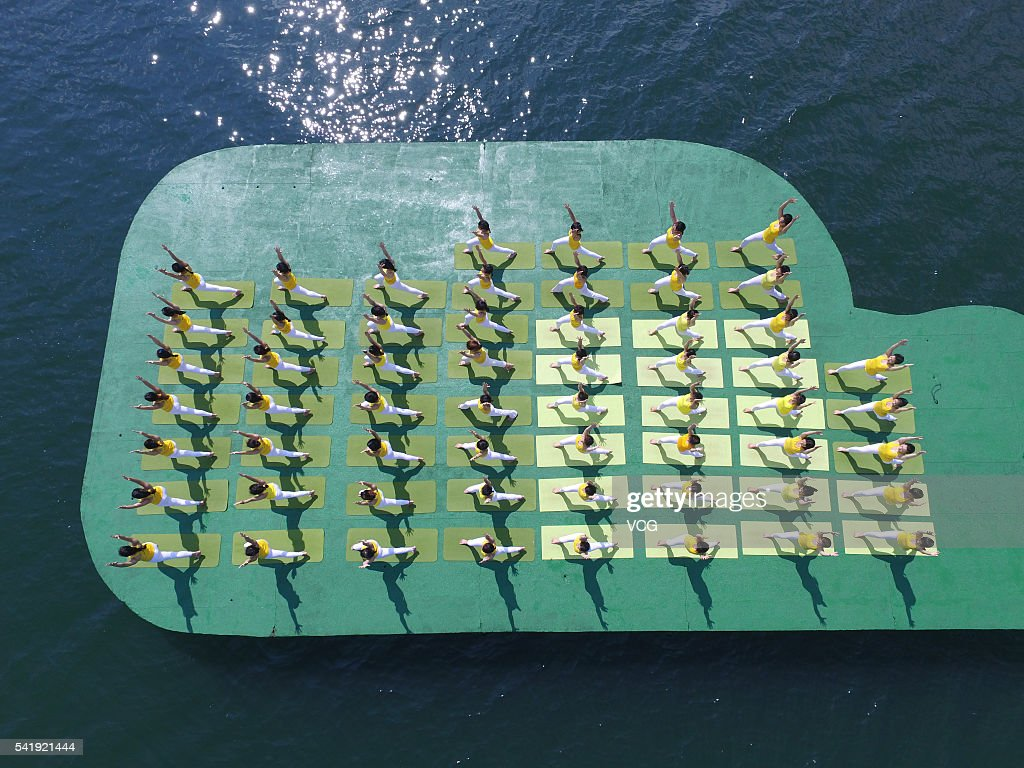 Aerial view of yoga enthusiasts practice yoga on the water of Shiyan Lake on June 21, 2016 in Changsha, Hunan Province of China. About 100 yoga enthusiasts perform yoga to welcome the International Day of Yoga which falls on June 21 each year.