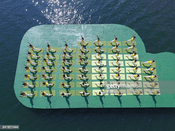 Aerial view of yoga enthusiasts practice yoga on the water of Shiyan Lake on June 21 2016 in Changsha Hunan Province of China About 100 yoga...
