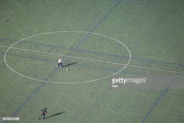 Aerial view of (wide view of) young man at football training