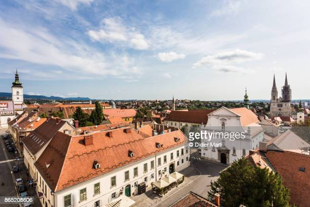 aerial view of zagreb skyline with saint mark church and the cathedral in croatia capital city. - zagreb stock pictures, royalty-free photos & images