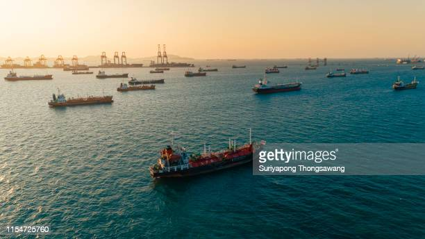 aerial view oil ship tanker carrier oil for transportation from refinery on the sea. - large group of objects stock pictures, royalty-free photos & images