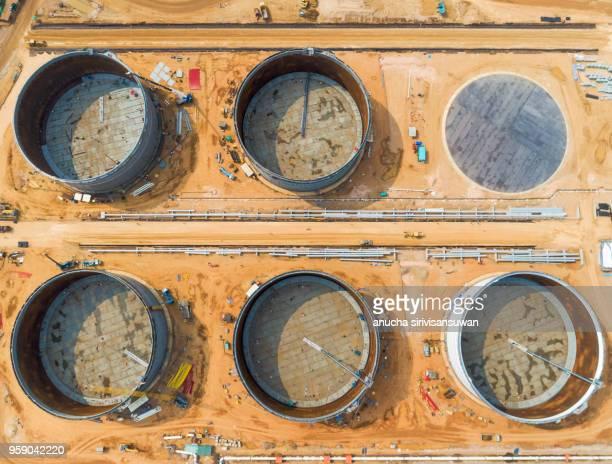 aerial view oil tank under construction in the refinery, thailand. - storage tank fotografías e imágenes de stock
