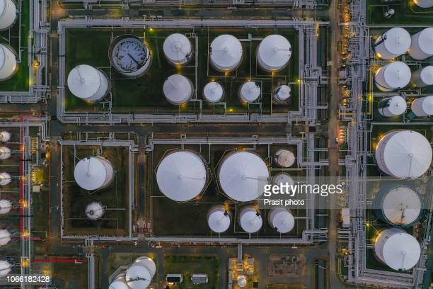 aerial view oil terminal is industrial facility for storage of oil and petrochemical products ready for transport to further storage facilities. - gas tank stock photos and pictures