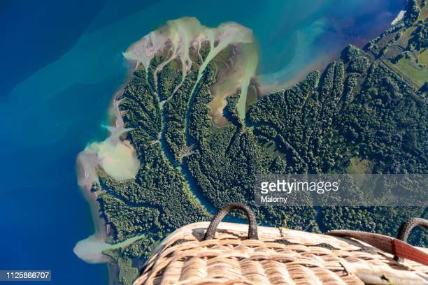 aerial view on a lake shore, a river and a nature reserve seen from a hot air balloon. - nature reserve stock-fotos und bilder