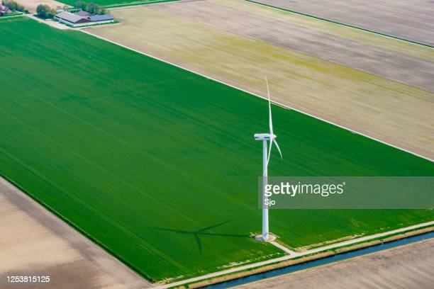 "aerial view on a wind turbine in an agricultural field - ""sjoerd van der wal"" or ""sjo"" stock pictures, royalty-free photos & images"