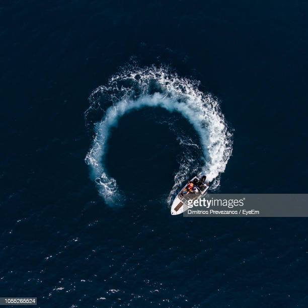 aerial view on boat in sea - circle stock pictures, royalty-free photos & images