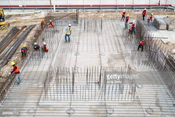 Aerial view on construction building. Construction site workers