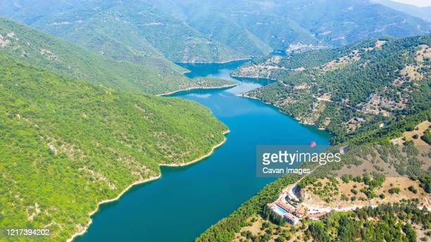 aerial view on green hills around vacha dam. - drainage_basin stock pictures, royalty-free photos & images