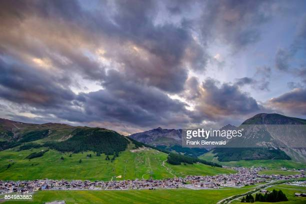Aerial view on Livigno town with the Engadine Mountains in the distance at sunset