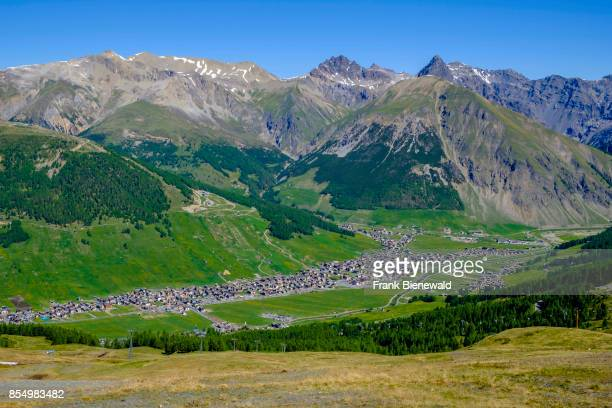Aerial view on Livigno town with the Engadine Mountains in the distance