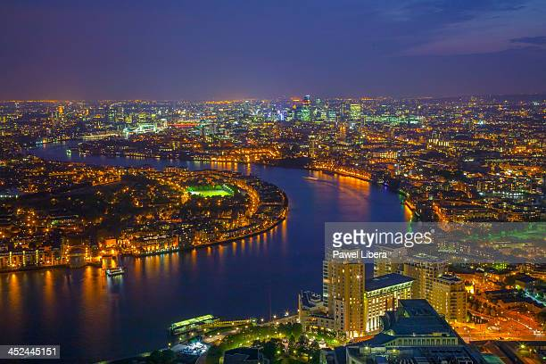 Aerial view on London skyline and River Thames at night from top of One Canada Square Tower aka Canary Wharf