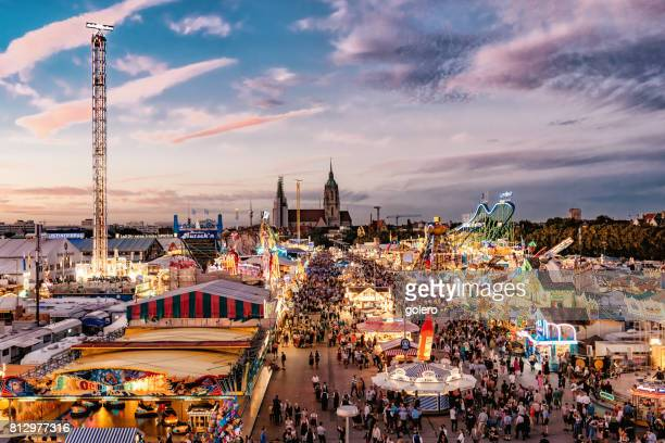 aerial view on oktoberfest in munich at sunset hour - munich stock pictures, royalty-free photos & images