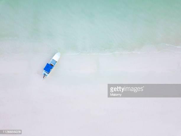 aerial view on small boat on the beach. - isla holbox fotografías e imágenes de stock