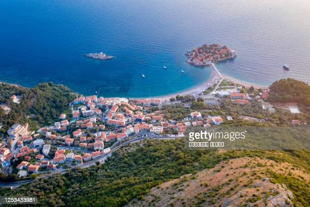 aerial view on sveti stefan island with road and coastal town. montenegro - kotor bay stock pictures, royalty-free photos & images