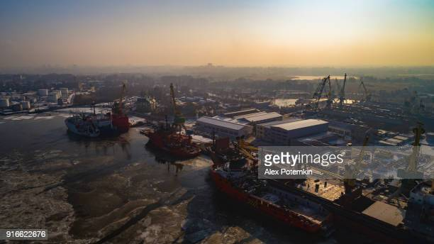 aerial view on the commercial docks in the north port on the frozen river in winter - kaliningrad stock pictures, royalty-free photos & images