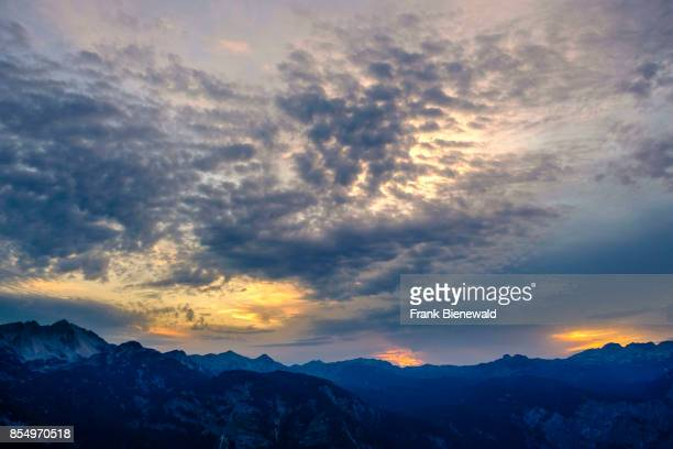 Aerial view on the mountains of Triglav National Park with dramatic clouds at sunset from Vogel cable car hill station