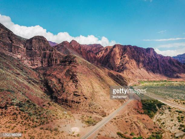 aerial view on the red rocky mountains of argentina - argentina stock pictures, royalty-free photos & images