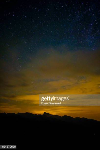 Aerial view on the summit of Mount Triglav with stars at night from Vogel cable car hill station at Lake Bohinj Bohinjsko jezero in Triglav National...