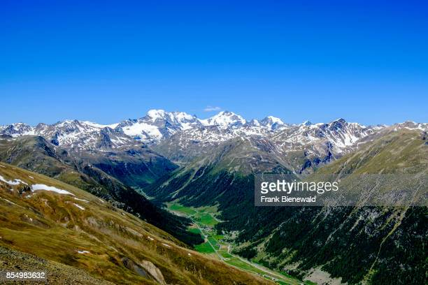 Aerial view on the valley of Livigno town with the Bernina Mountains in the distance