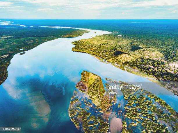 aerial view on the zambezi under blue sky - southern africa stock pictures, royalty-free photos & images