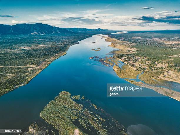 aerial view on the zambezi under blue sky - estuary stock pictures, royalty-free photos & images