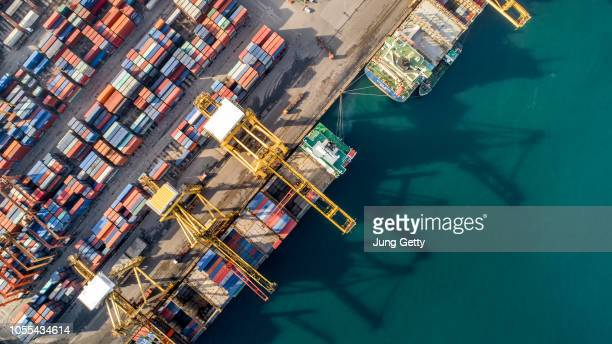 aerial view or top view of cargo ship, cargo container in warehouse harbor ,shipyard import export logistics concept for background - shipyard stock pictures, royalty-free photos & images