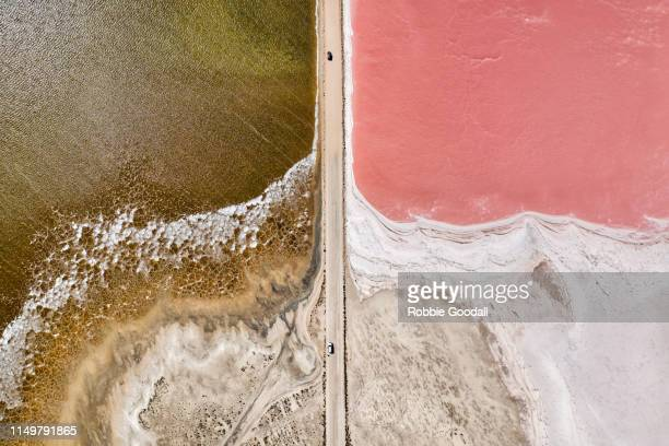 aerial view over a pink salt lake in south australia - horizontal stock pictures, royalty-free photos & images