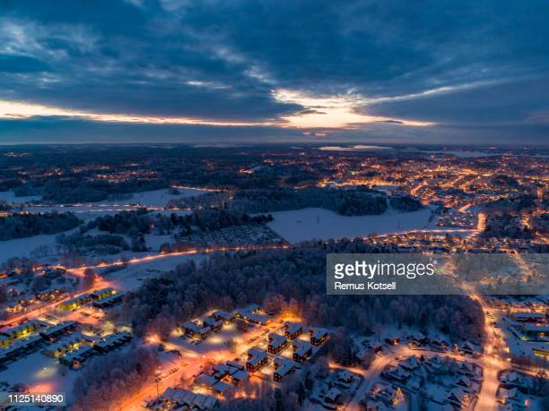 aerial view over a small city - illuminated stock pictures, royalty-free photos & images