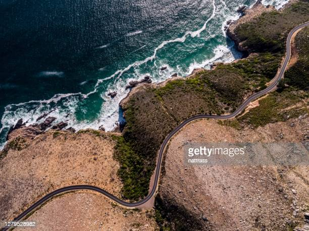 aerial view over a winding coastal road - western cape province stock pictures, royalty-free photos & images